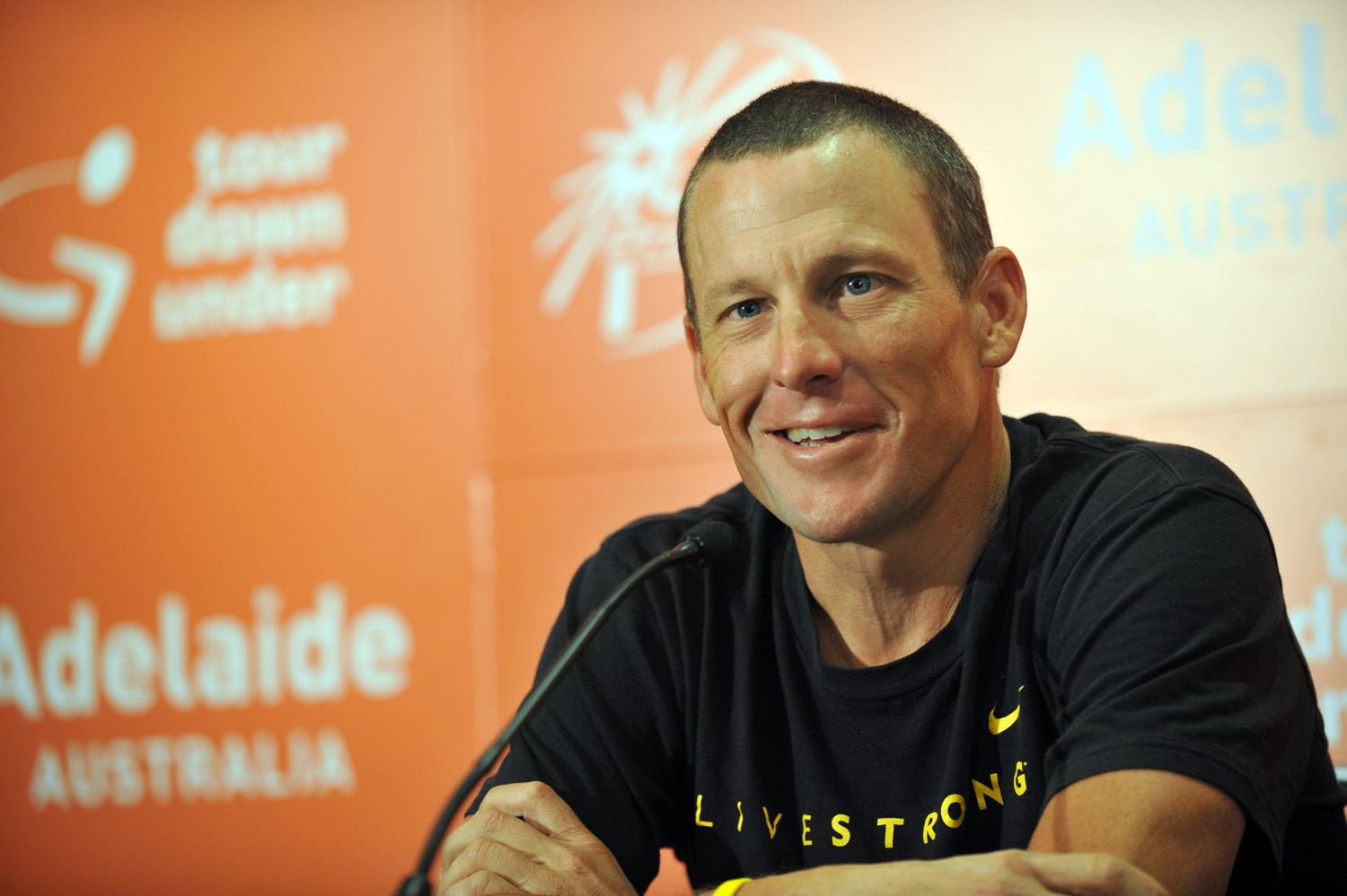 Lance Armstrong meets the press