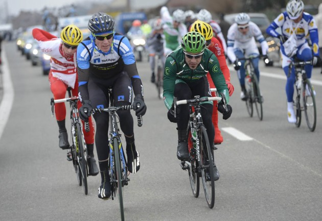 Photo: Zak Dempster leads an escape in the Omloop Het Nieuwsblad .