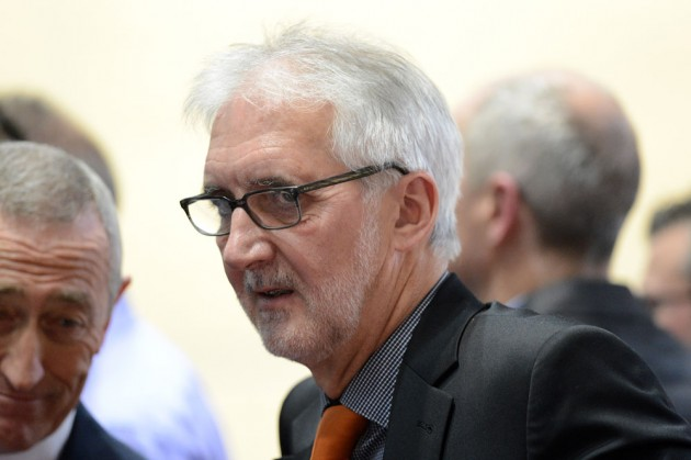 Photo: Brian Cookson says women at the UCI have warned against introducing a minimum wage for female cyclists as it could lead to fewer professional teams .