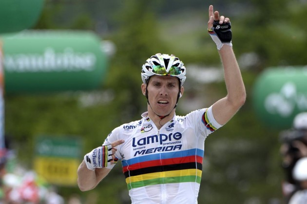 Photo: Rui Costa celebrates winning the 2014 Tour de Suisse .