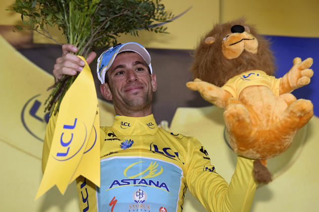 Photo: Vincenzo Nibali on the podium after retaining the yellow jersey on Stage 6 of the 2014 Tour de France ...