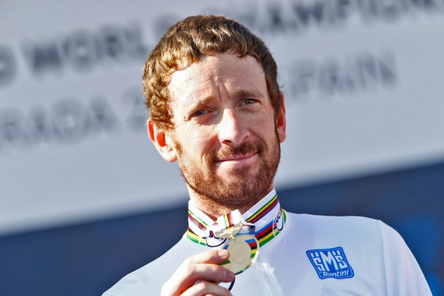 Photo: Sir Bradley Wiggins on the podium after winning the Elite Mens TT at the 2014 World Championships .