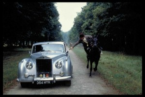 Bond in Motion. Rolls Royce Silver Cloud with Bond (Roger Moore) attempting to escape by leaping into the car from his horse