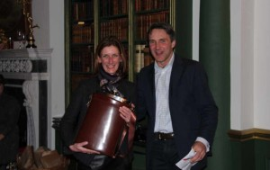 Winner Kate Hayward is presented with the Growler hip flask by Richard Wright, Chairman of the Northamptonshire GWCT