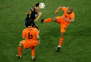 Nigel de Jong plants his studs into the chest of Xabi Alonso.