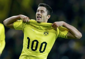 Borussia Dortmund's Lewandowski celebrates after scoring against WfL Wolfsburg during German soccer cup semi-final match in Dortmund