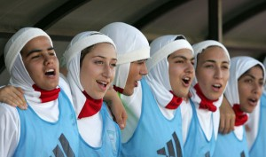 Archive footage of the Iranian women's football team, all wearing the headscarf.