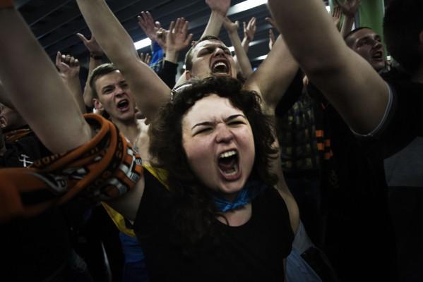 Supporters of Ukrainian soccer team Shakthar Donetsk chants pro-Ukrainian slogans during the soccer match between Shakthar Donetsk and Tavriya Sinferopol, played in Donetsk, eastern Ukraine, Wednesday, April 23, 2014. (AP Photo/Manu Brabo)