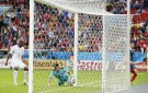 Honduras' goalkeeper Noel Valladares bundles a shot from France's Karim Benzema over the  line