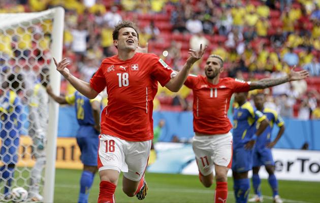 Admir Mehmedi celebrates after heading Switzerland level.