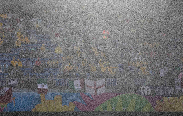 Visibility impaired... rain pours down during Mexico's match with Cameroon.