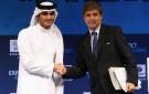 Harold Mayne-Nicholls, right, shakes hands with Sheik Mohammed bin Hamad bin Khalifa Al Thani