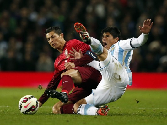 Argentina's Roncaglia challenges Portugal's Ronaldo during their international friendly soccer match at Old Trafford in Manchester