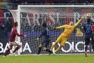 AC Milan's Menez shoots to score past Inter Milan's goalkeeper Handanovic during their Italian Serie A soccer match at the San Siro stadium in Milan