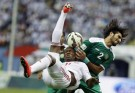 Ahmed Aljneibi of the United Arab Emirates fights for the ball with Ahmed Khalaf of Iraq during their Gulf Cup soccer match in Riyadh