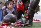 A young boy looks at a statue of late Portuguese football player Eusebio da Silva Ferreira, also known as the 'Black Panther', outside the Luz stadium in Lisbon on January 5, 2014.