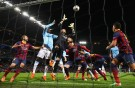 Victor Valdes of Barcelona rises to make a save under pressure during the UEFA Champions League Round of 16 first leg match between Manchester City and Barcelona at the Etihad Stadium
