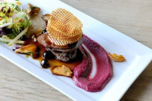 Wood pigeon with blueberry jus