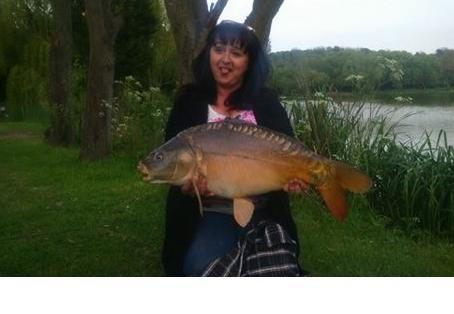 Mirror carp: My First Double with a cheeky gesture to my seething son