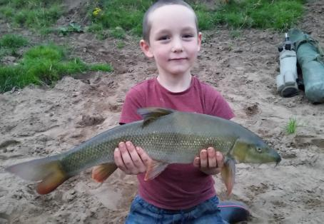 Barbel: Eli age 6 first barbel river Ribble.