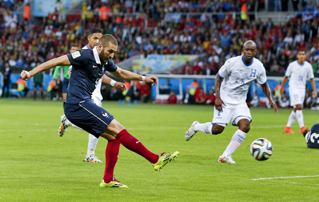 Karim Benzema smashes in his second and France's third goal of the tournament.