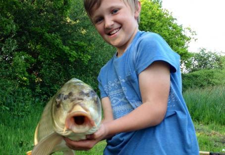 Koi carp: Whose got the biggest smile? Angler or fish?!..