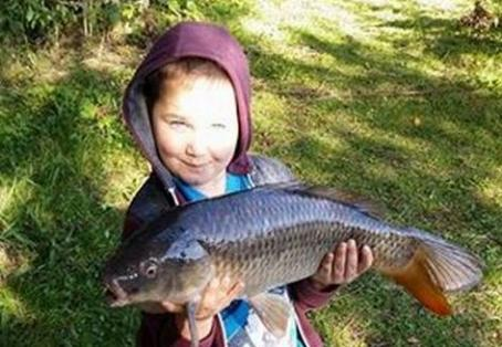 Common carp: My great grandson, Jayden, aged 6. Nice fish.