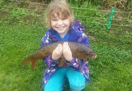 Common carp: My daughter's first carp catch