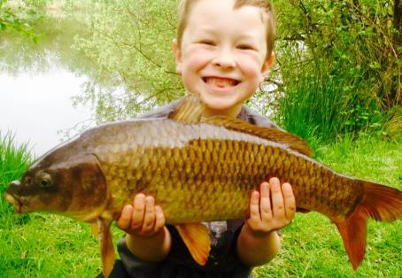 Common carp: 6 year old Ollie Burton catching his first fish!!!