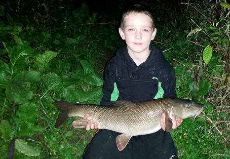 Barbel: Eli with a 10 lb 01 oz river Ribble barbel.